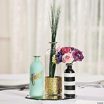 Glass bottle centerpiece idea for Glass bottle centerpieces