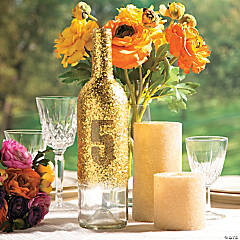 glittered bottle table number centerpiece idea - Centerpiece Ideas