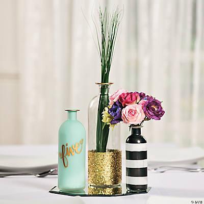 Glass bottle centerpiece idea for Glass bottle centerpiece ideas