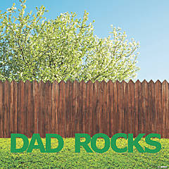 Dad Rocks Green Letters Yard Sign